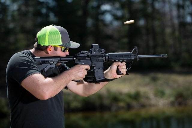 Man shooting ar-15 rifle