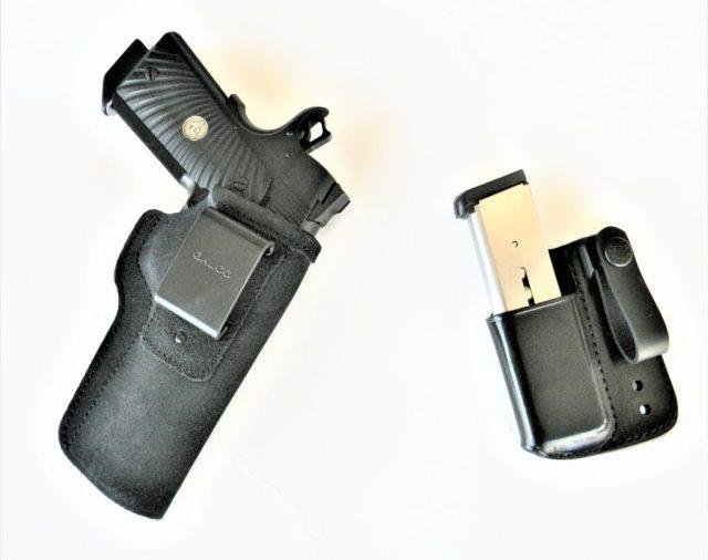 handgun in holster and magazine in carrier