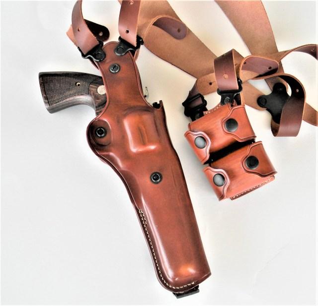 Shoulder holster with revolver and speedloaders