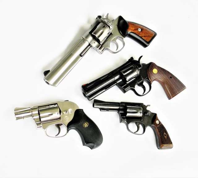 Four revolvers of different sizes