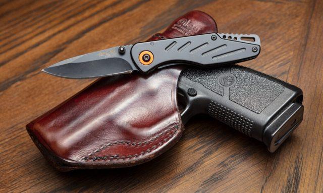 knife on handgun in holster