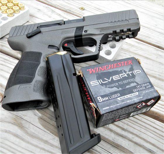 Winchester Silvertip and Handgun