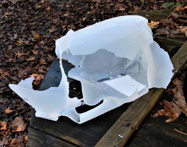 Shredded gallon water jug that was shot