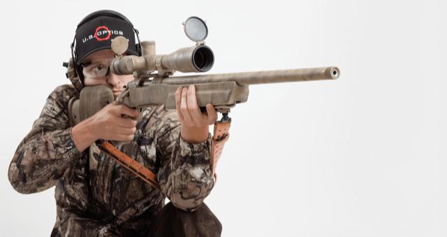 Man with Remington 700 Rifle