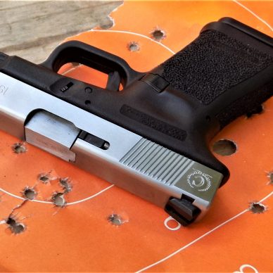 customized GLOCK pistol on orange target