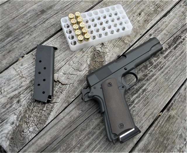 Tisas 1911 on table with ammo