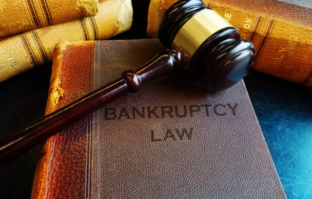 Bankruptcy Law books with court gavel NRA