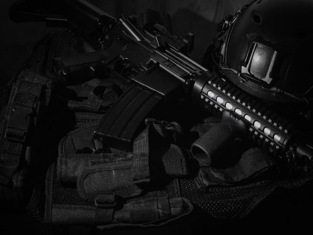 AR-15 Rifle on Black Tactical Gear