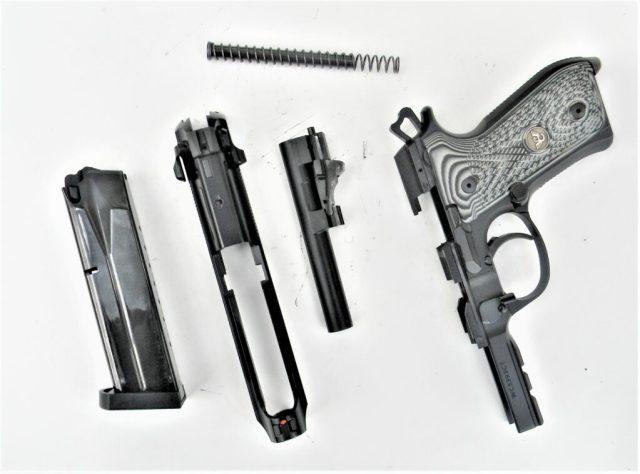 disassembled Beretta pistol