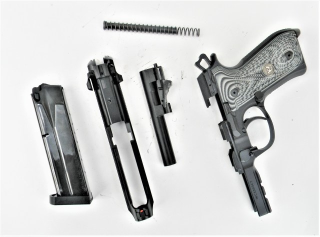 disassembled Beretta pistol