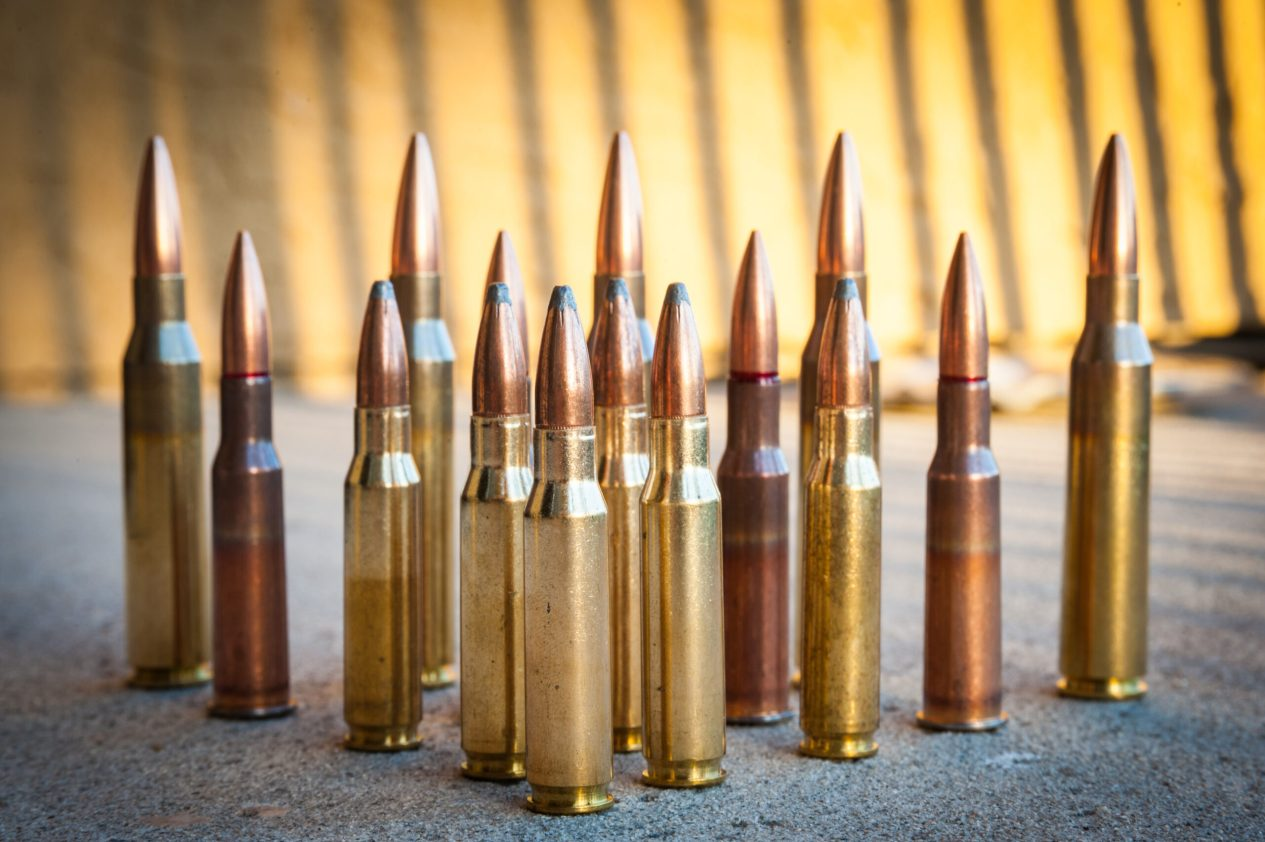 Various types and sizes of rifle Ammunition calibers of arranged in triangle formation