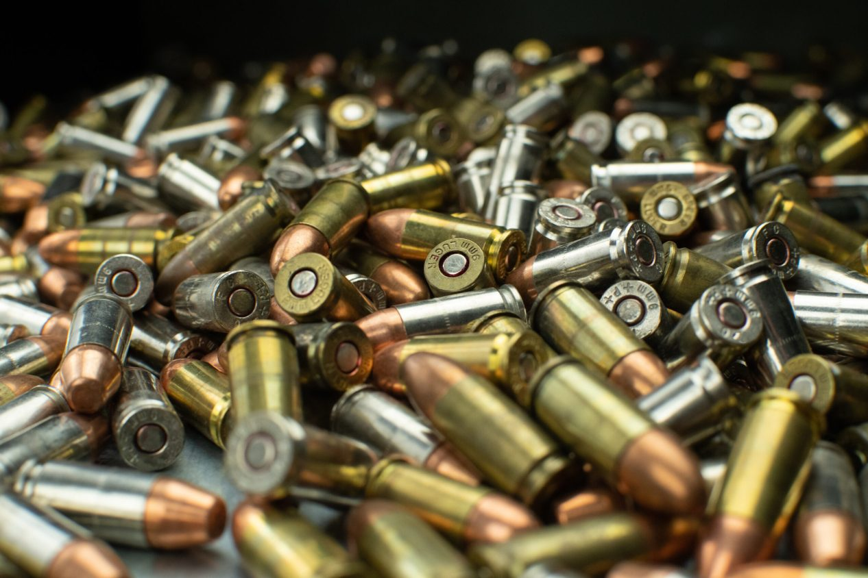 large pile of assorted handgun ammunition