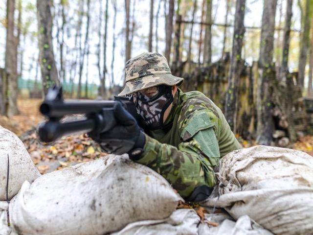 man in camo shooting shotgun, shooting exercises