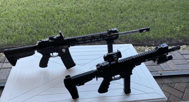AR-15 rifle and AR-15 pistol on wood table