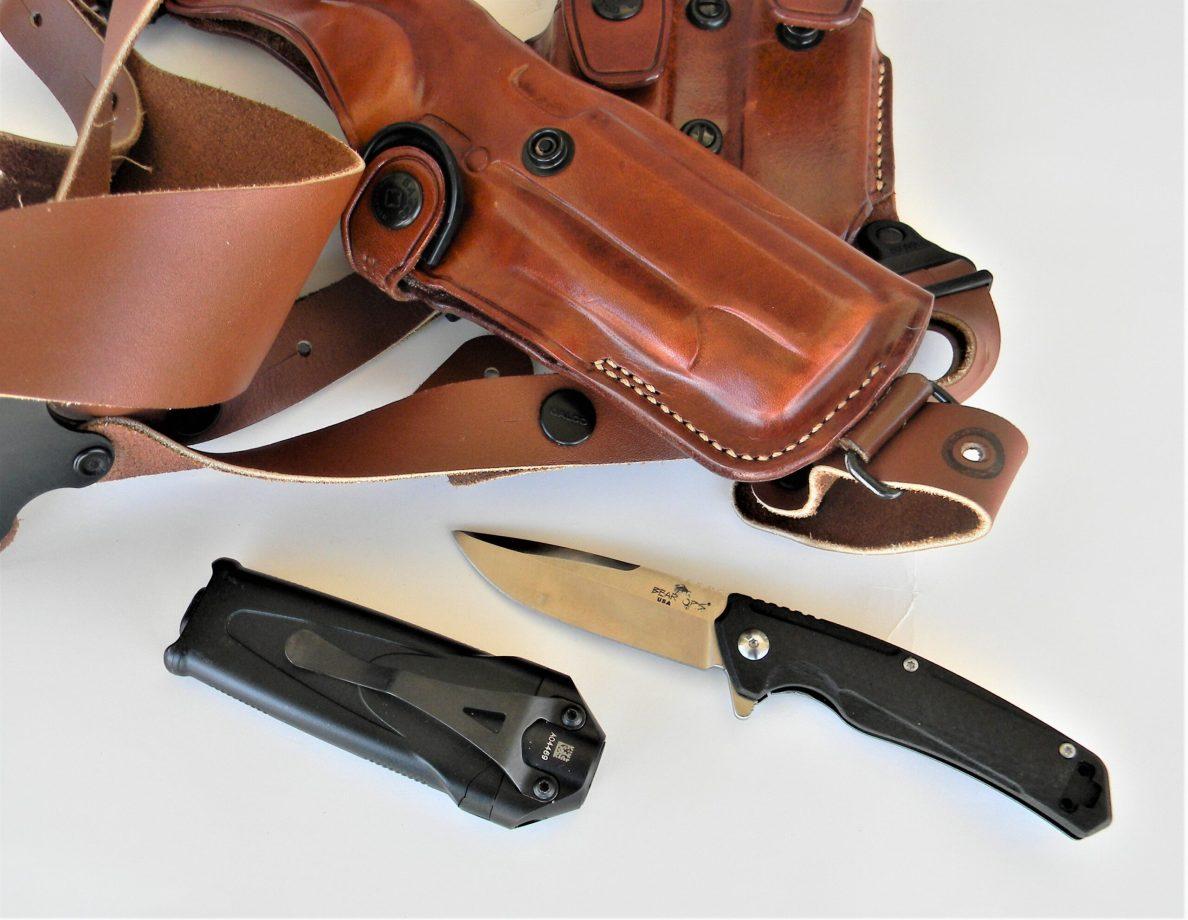 pocket knife, flashlight and leather shoulder holster