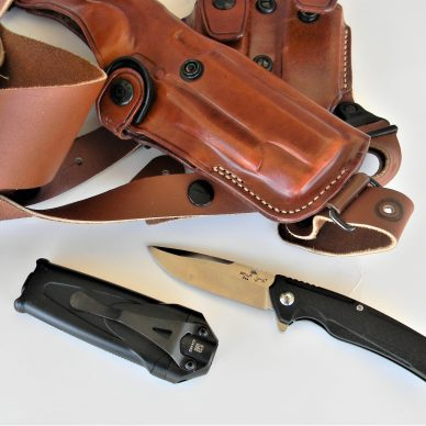 pocket knife, flashlight and leather shoulder holster