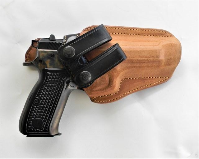 handgun in leather holster