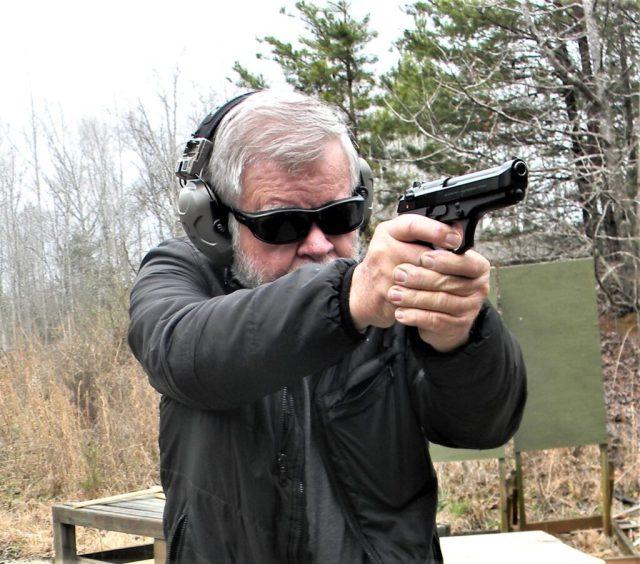 Man firing Beretta 92 Compact