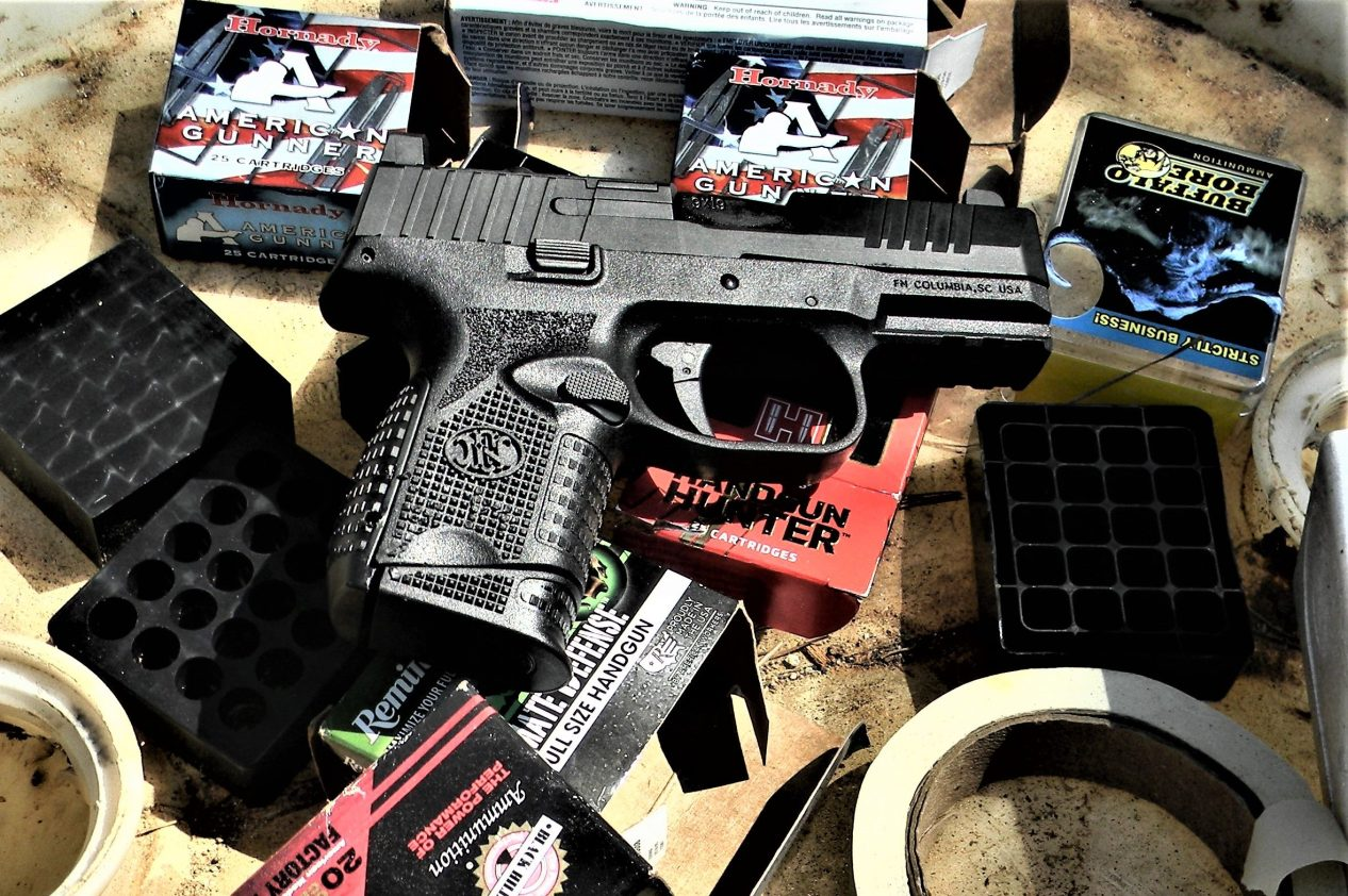 FN 509 Compact pistol on shooting gear