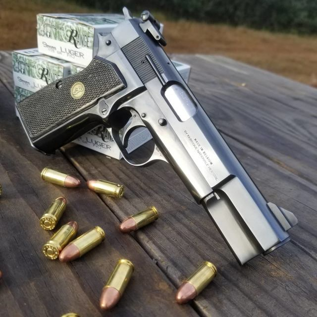 Browning Hi-Power on Wood Table with Ammo