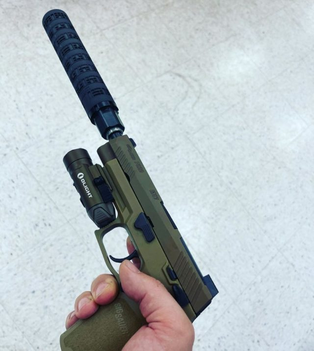 SIG M17 pistol with light and suppressor