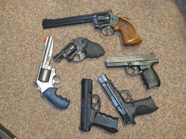 3 revolvers and 3 pistols on floor