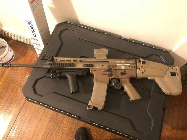 FN SCAR rifle on plastic tub