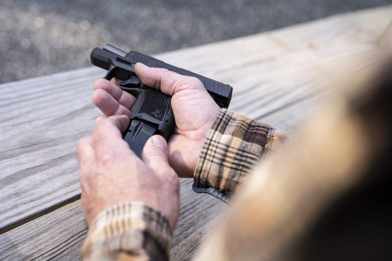 Man Shooting Taurus GX4 Pistol