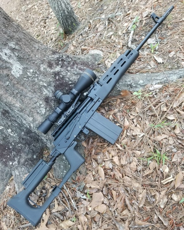 Ak-Style rifle leaning on tree