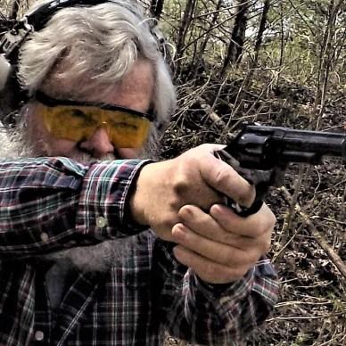 man shooting revolver