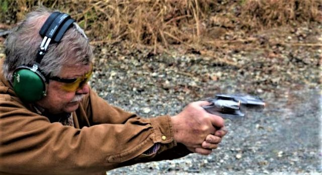 man shooting double-action revolver