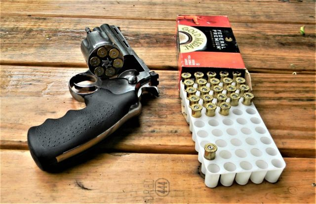 Colt Python on Wood Table with Ammo
