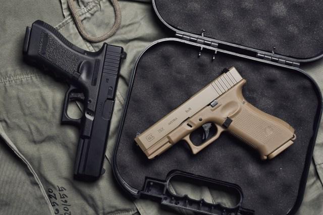 Two GLOCK pistols on case