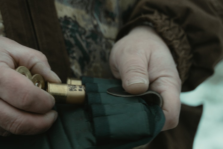 man pulling ammo out of pouch