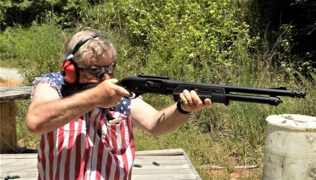 Man shooting best pump-action shotguns
