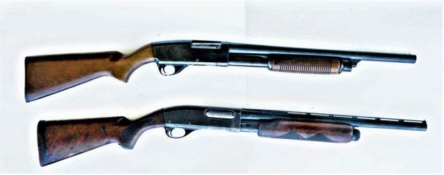 two pump-action shotguns