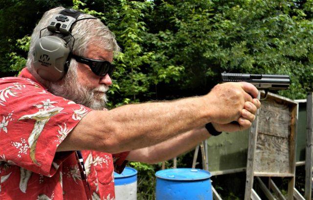 man shooting FMK 9C1 G2 pistol