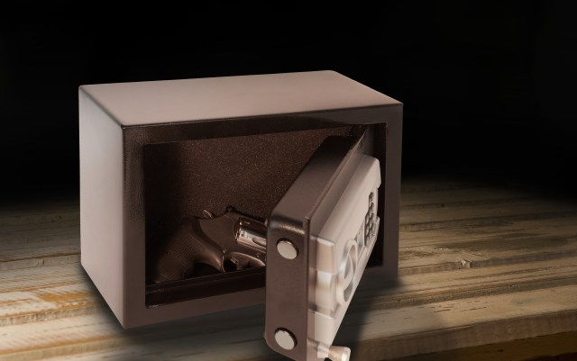 Revolver in safe on table