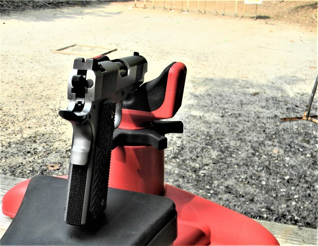 Commander length 1911 piston sitting on MTM K Zone pistol rest on a shooting bench