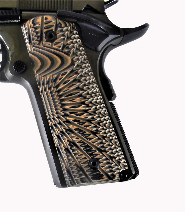 close up of g10 grips on 1911 handgun