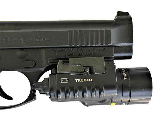 TruGlo weapon light attached to light rail on a pistol