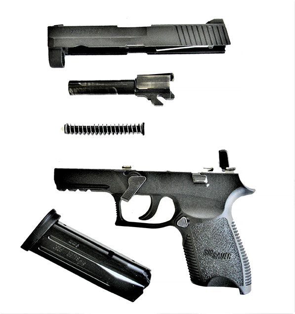Field stripped SIG P250 9mm pistol
