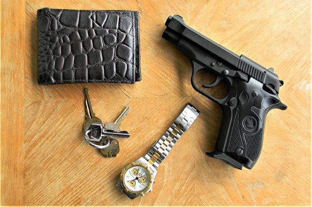 pocket dump showing a Fatih pistol, wrist watch, keys, and wallet