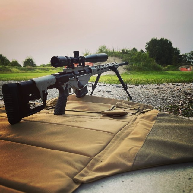 bolt action rifle on shooting mat