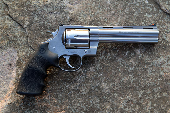 Colt Anaconda Revolver .44 magnum right profile stainless-steel with a rock as a background