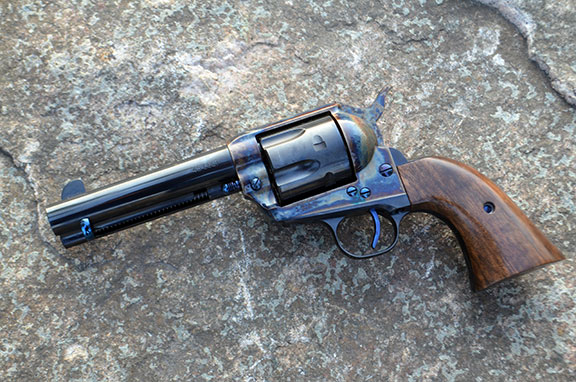 Standard Manufacturing Single Action Revolver left profile with a stone background