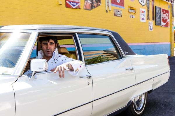 Las Vegas, Nevada. USA. Elvis impersonator on break in his cadillac.
