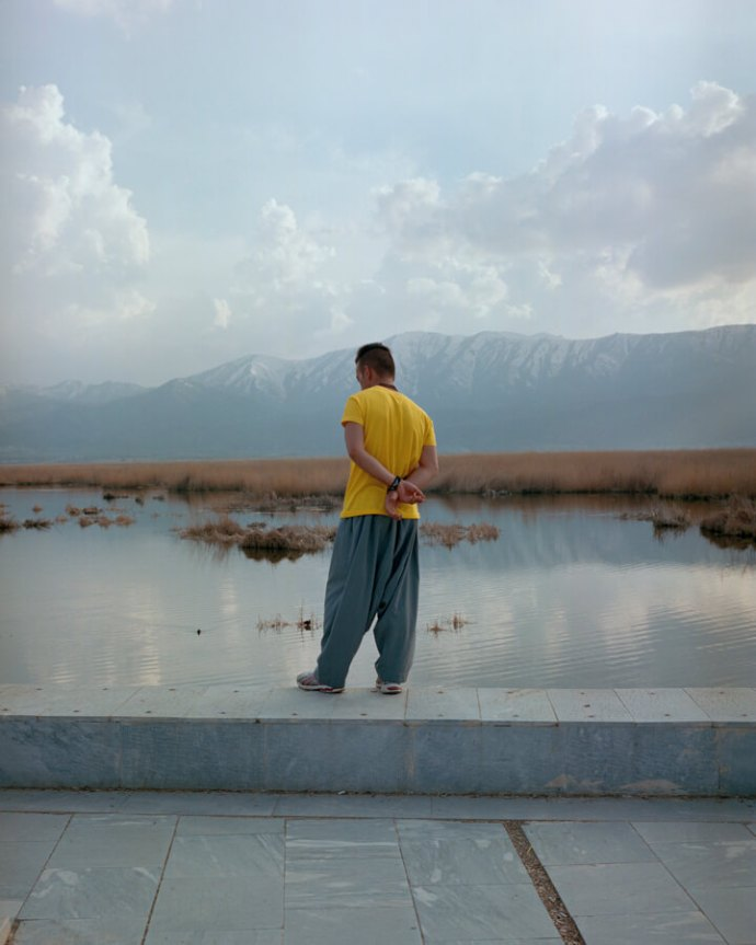 Iran by Sarah Pannel - men standing next to water