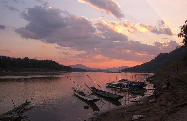 Sunset over the Mekong River, near Luang Prabang, Laos.