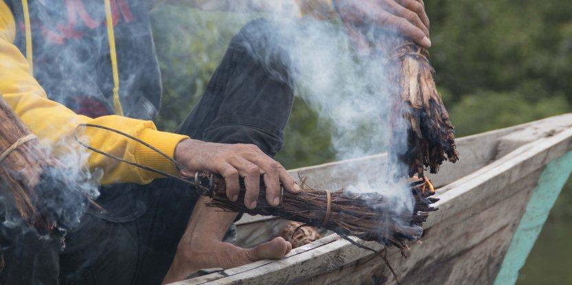 Locals burn wood in preparation for honey harvesting in Kapuas Hulu, Kalimantan.